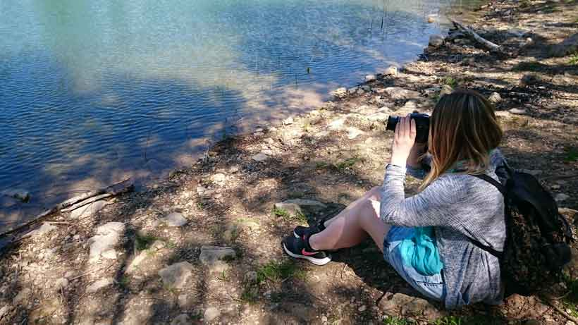 Brie-Anne taking photos at the lake lac du cres