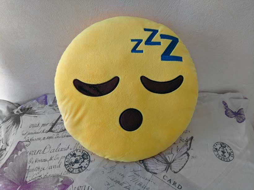 snoozing emoji pillow waking up early